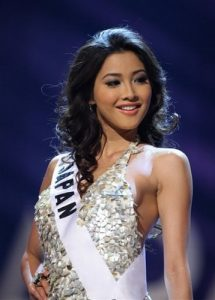 Miss Japan Emiri Miyasaka poses on the runway in the evening gown segment of the 2009 Miss Universe Preliminary Competition, at Atlantis, Paradise Island, Bahamas, Sunday, Aug. 16, 2009. During the Aug. 23 final pageant, Miss Universe will be picked from among contestants from 84 countries. (AP Photo/Tim Aylen)